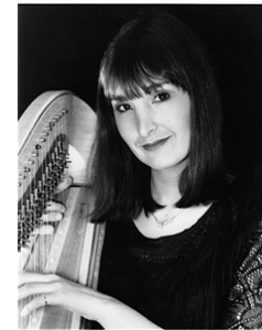 black and white close up photo of Carol Robbins holding her harp
