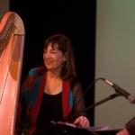 Photo of Carol Robbins with her harp beside saxophonist Bob Sheppard